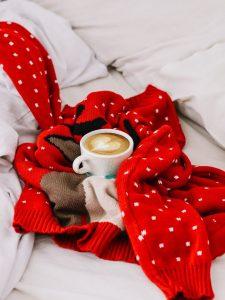 white ceramic mug with latte art with festive christmas jumper