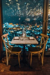 dining chairs and table set over skyscraper setting