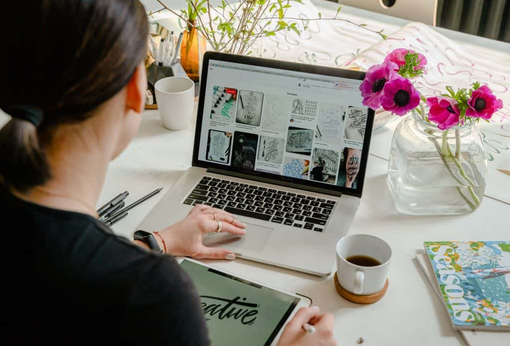 photo of person using laptop for graphic designs 7 tips for new bloggers and what I wish I'd known before starting a blog